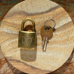 80s Louis Vuitton lock and key set